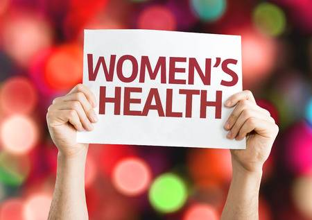 58162940-hands-holding-women-s-health-card-bokeh-background